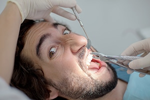 Man looking nervous in dentists chair