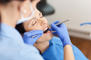 Woman having dental procedure